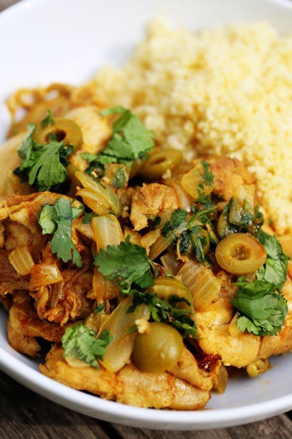 Moroccan chicken recipe in a white bowl.