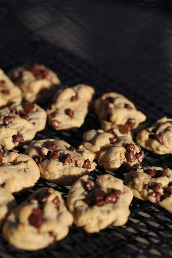 Chocolate chip cookies with brown butter on cooling rack.