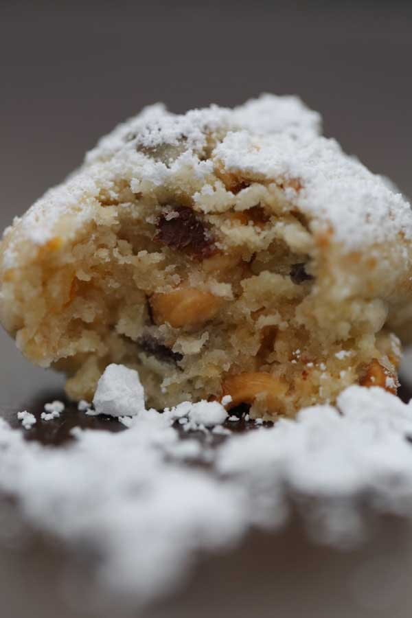 orange zest snowball cookie with bite