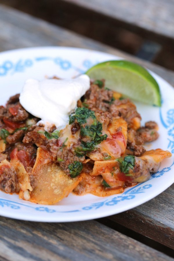 Serving of beef enchilada casserole on a plate.