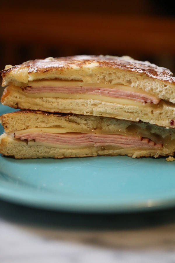 Monte cristo sandwich on blue plate.