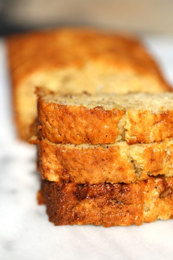 Banana bread with sour cream on a marble cutting board.