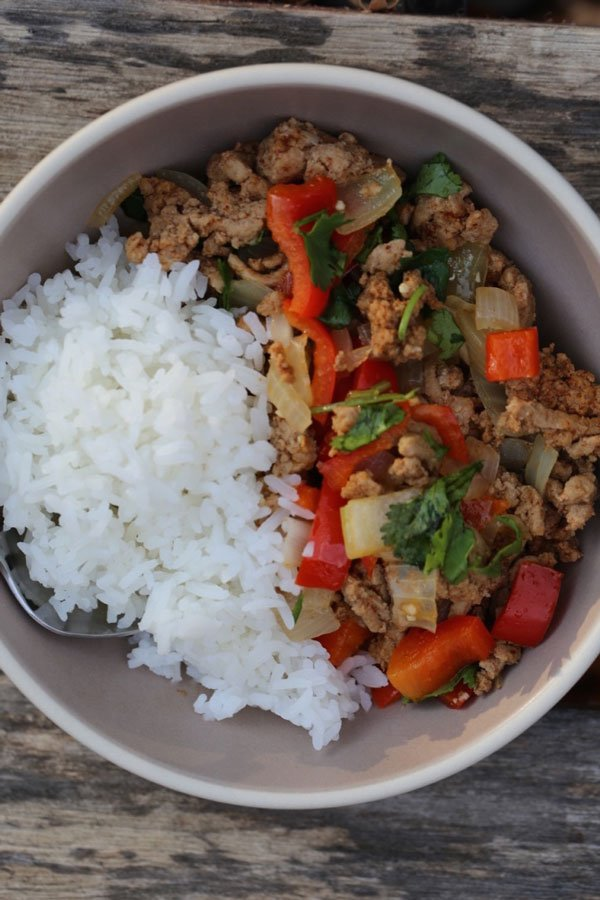 Ground turkey dinner in brown bowl with rice.