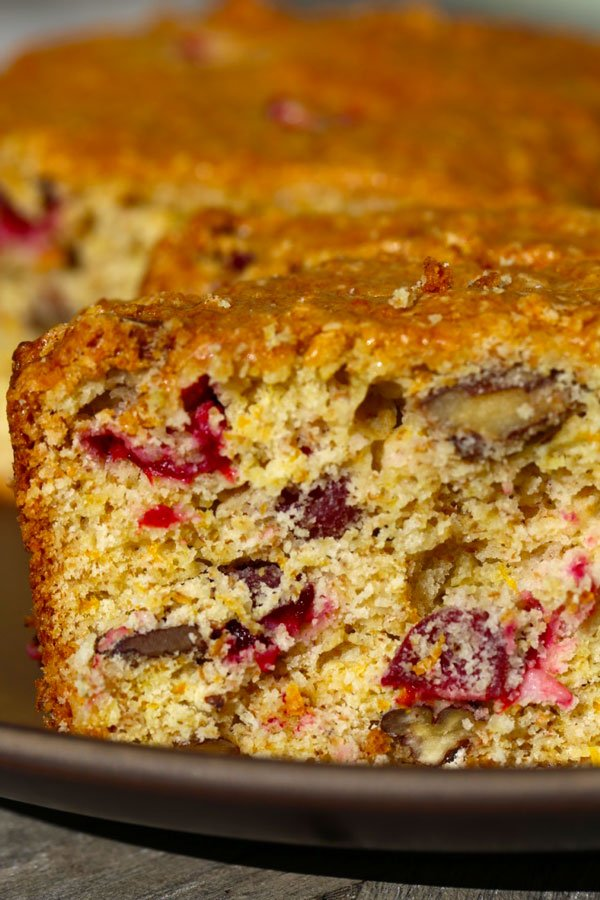 Cranberry nut bread on brown plate.
