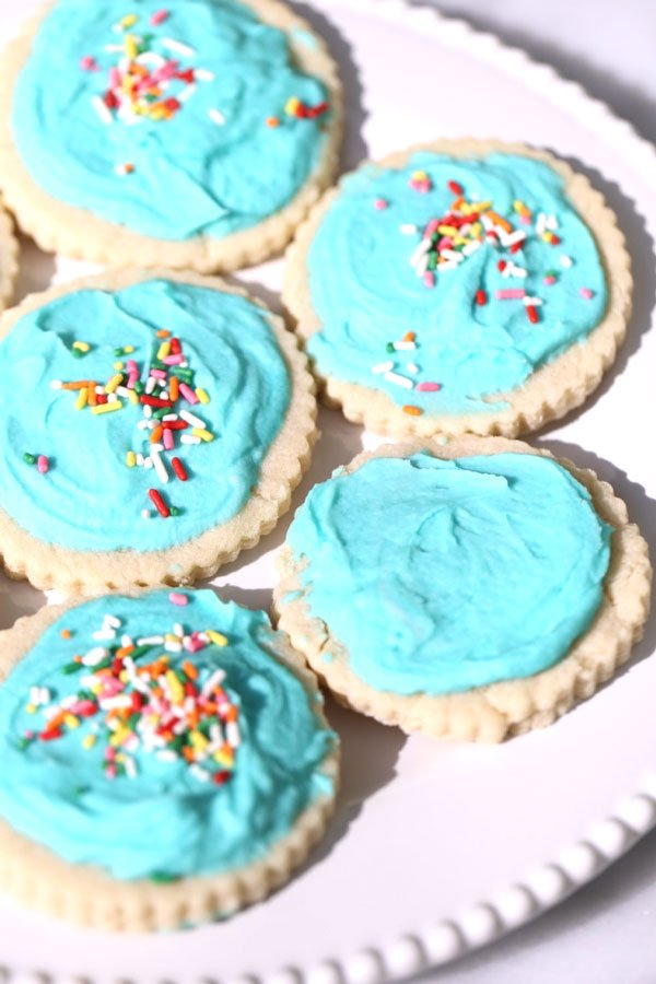 Cookies from soft sugar cookie recipe on white plate.
