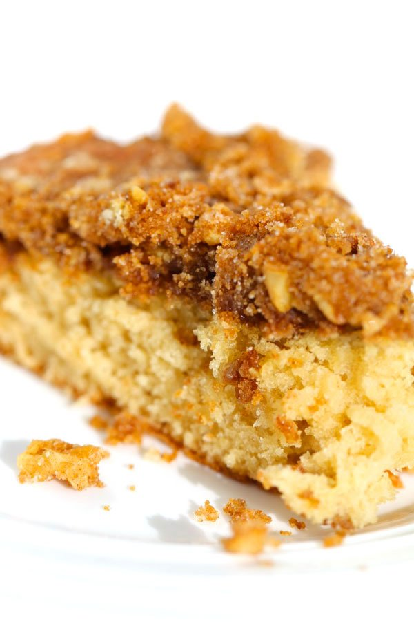 One slice of cinnamon coffee cake with walnut streusel topping.