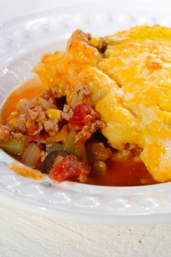 Slice of tamale pie in white bowl.