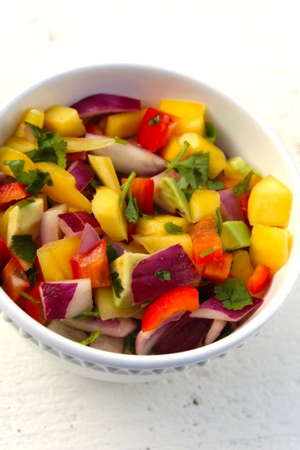 Mango Salsa in a bowl on a white table.