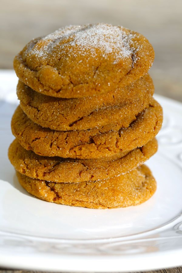 Stack of soft ginger cookies on a white plate.