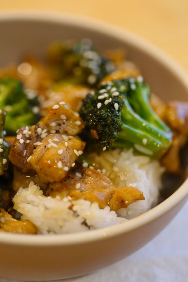 Chicken Broccoli Stir Fry in a brown bowl with rice.