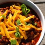 Texas chili in a white bowl