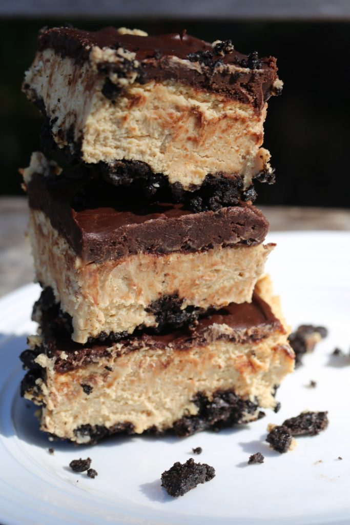 Chocolate Peanut Butter cheesecake bars on a plate