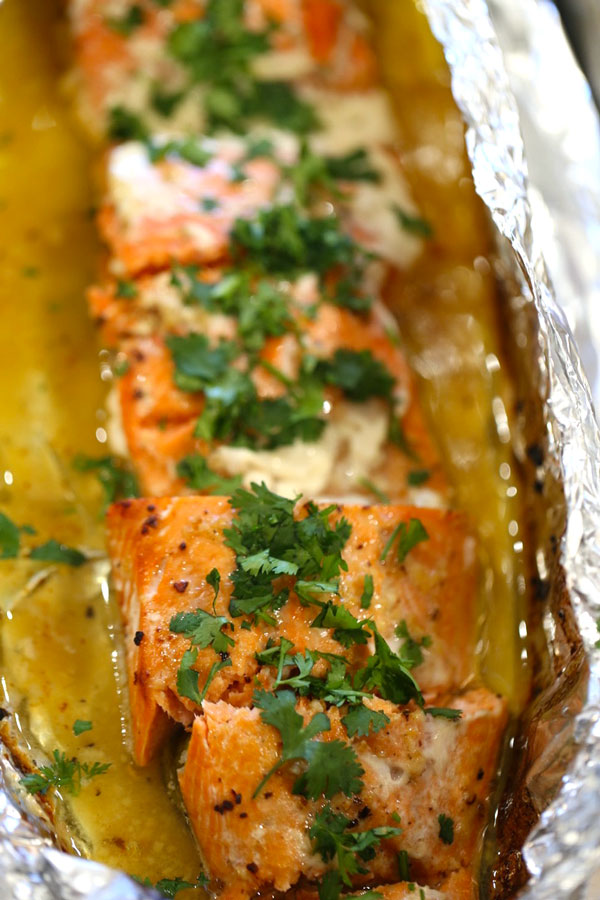 Baked salmon in foil with honey lime sauce