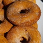 Easy baked pumpkin donuts recipe that creates super festive holiday treats that are delicious beyond compare.