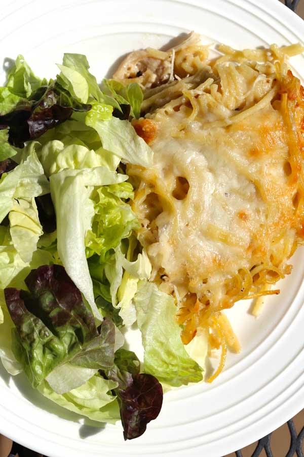Cheesy Chicken Tetrazzini on a white plate.