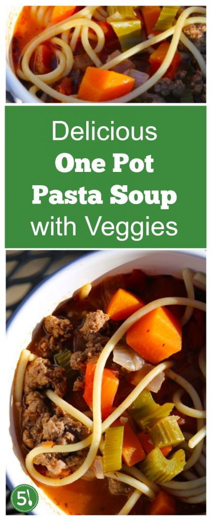 Pasta soup with ground beef and veggies in a white bowl.