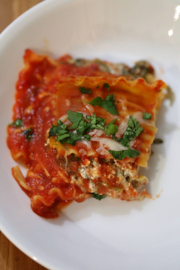 Slice of easy vegetarian lasagna on a white plate.
