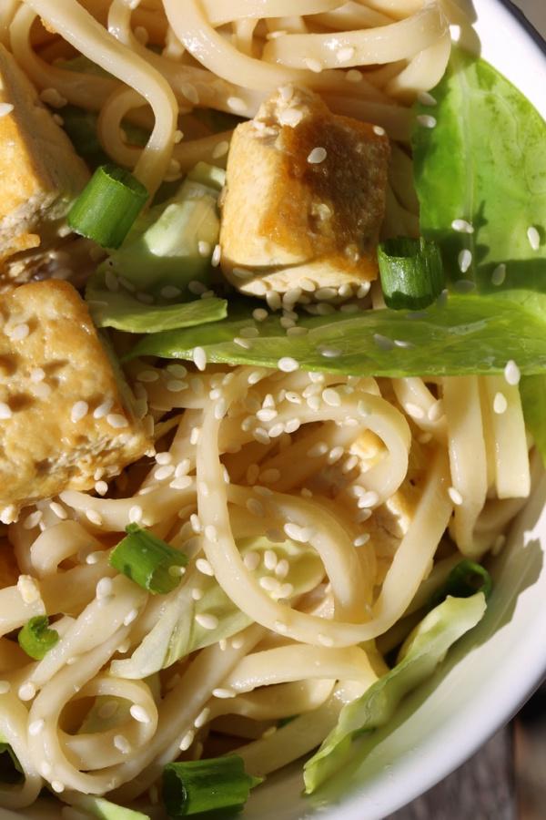 Tofu pasta in a white bowl.